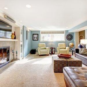 25561339 - light blue living room with leather furniture set, beige carpet floor, tv and fireplace